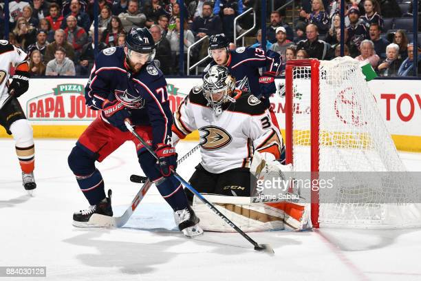 Nick Foligno of the Columbus Blue Jackets controls the puck as goaltender John Gibson of the Anaheim Ducks defends the net during the third period of...