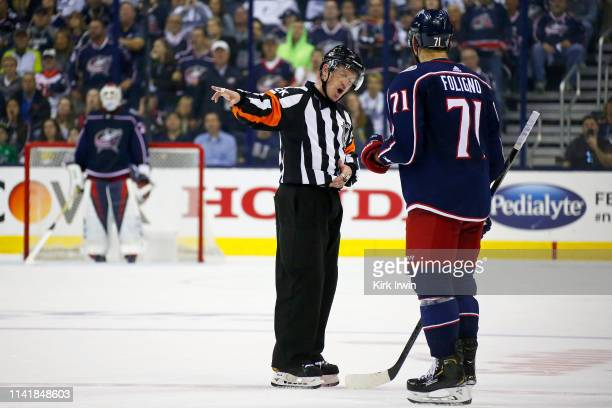 Nick Foligno of the Columbus Blue Jackets discusses a call with referee Kelly Sutherland during the second period in Game Six of the Eastern...