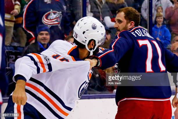 Nick Foligno of the Columbus Blue Jackets fights with Jujhar Khaira of the Edmonton Oilers during the game on December 12 2017 at Nationwide Arena in...