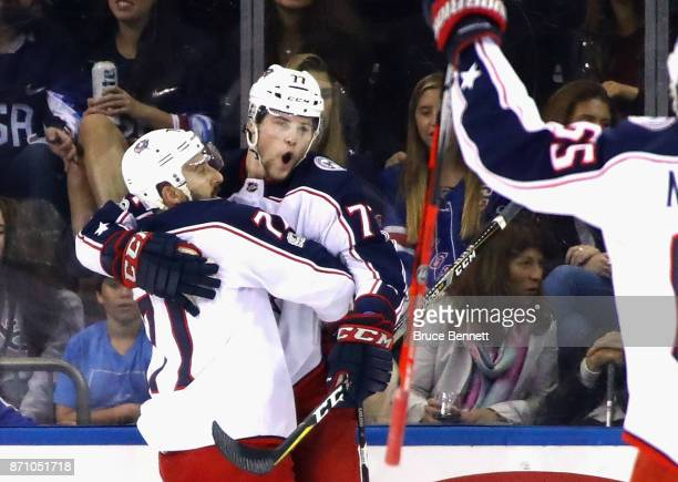 Nick Foligno of the Columbus Blue Jackets higs Josh Anderson after Anderson's second period goal against the New York Rangers at Madison Square...