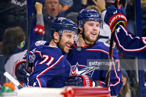 Nick Foligno of the Columbus Blue Jackets is congratulated by Josh Anderson after scoring a goal during the second period of the game against the New...