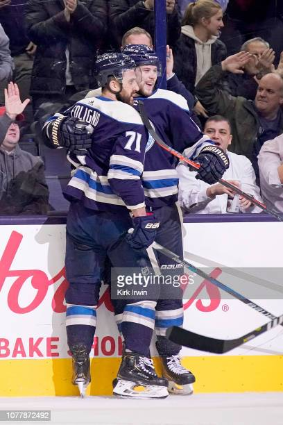 Nick Foligno of the Columbus Blue Jackets is congratulated by Josh Anderson after scoring a goal during the game against the Calgary Flames on...