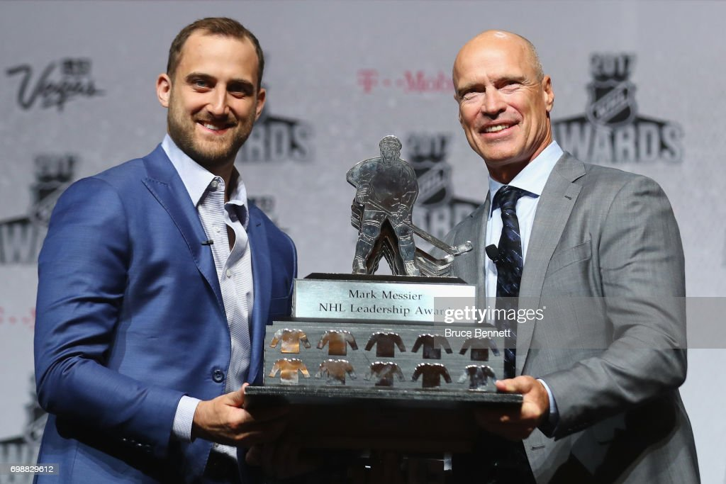 Nick Foligno of the Columbus Blue Jackets (L) is presented with the Mark Messier Leadership Award by Mark Messier (R) during the 2017 NHL Humanitarian Awards at Encore Las Vegas on June 20, 2017 in Las Vegas, Nevada.