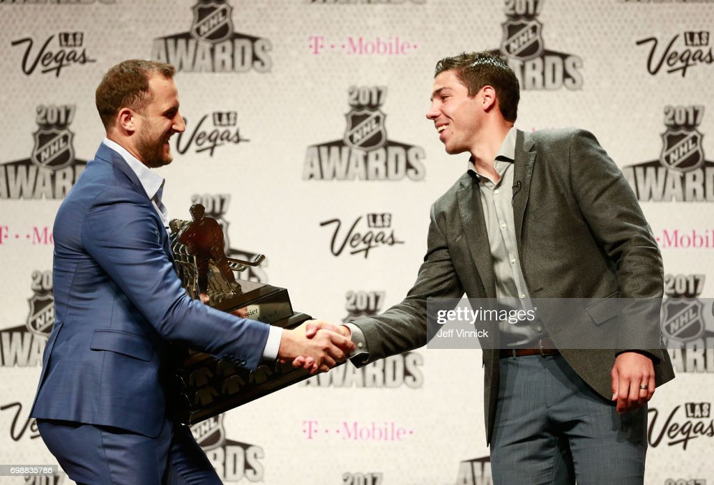 Nick Foligno of the Columbus Blue Jackets, left, and Travis Hamonic of the New York Islanders shake hands onstage during the 2017 NHL Humanitarian Awards on June 20, 2017 in Las Vegas, Nevada.