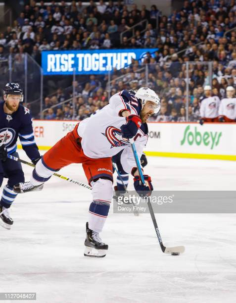 Nick Foligno of the Columbus Blue Jackets plays the puck down the ice during third period action against the Winnipeg Jets at the Bell MTS Place on...