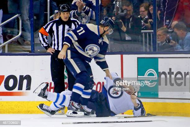 Nick Foligno of the Columbus Blue Jackets prepares to throw a punch during a fight with Adam Pardy of the Winnipeg Jets during the first period on...