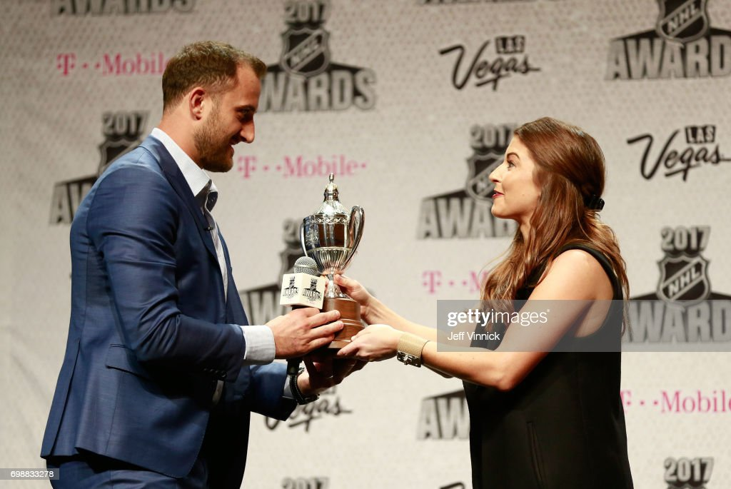 Nick Foligno of the Columbus Blue Jackets receives the King Clancy Memorial Trophy award from Megan Cooper of the NHL during the 2017 NHL Humanitarian Awards on June 20, 2017 in Las Vegas, Nevada.