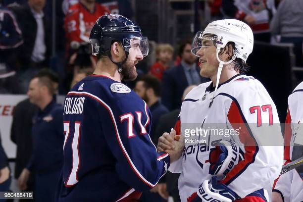 Nick Foligno of the Columbus Blue Jackets shakes hands with TJ Oshie of the Washington Capitals at the end Game Six of the Eastern Conference First...