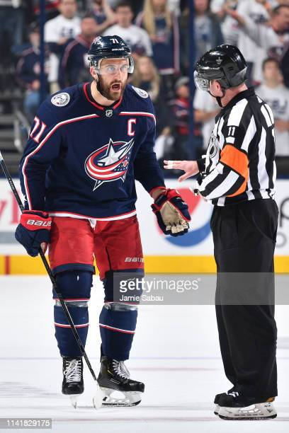 Nick Foligno of the Columbus Blue Jackets talks with referee Kelly Sutherland during the second period in Game Six of the Eastern Conference Second...