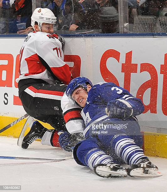 Nick Foligno of the Ottawa Senators and Dion Phaneuf of the Toronto Maple Leafs crash into the end boards during game action November 2, 2010 at the...
