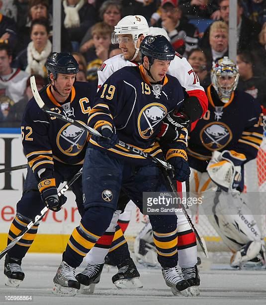 Nick Foligno of the Ottawa Senators battles for position with Tim Connolly and Craig Rivet both of the Buffalo Sabres during their NHL game at HSBC...