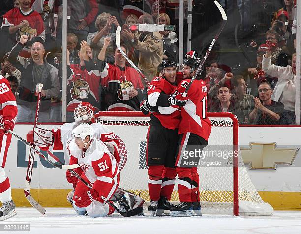 Nick Foligno of the Ottawa Senators celebrates his second period goal against Chris Osgood and Valtteri Filppula of the Detroit Red Wings with team...