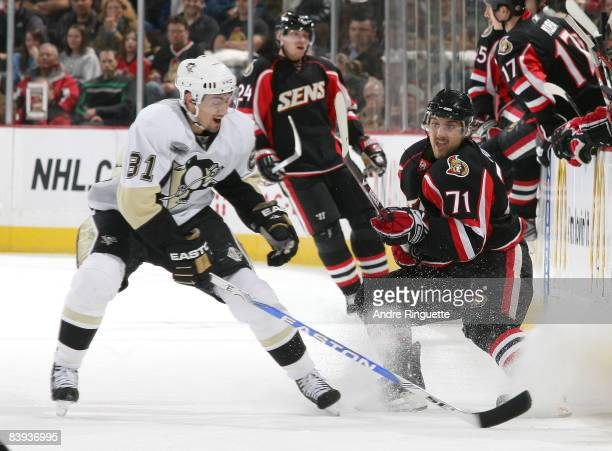 Nick Foligno of the Ottawa Senators flips the puck up past Miroslav Satan of the Pittsburgh Penguins at Scotiabank Place on December 6 2008 in Ottawa...