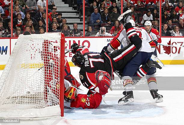 Nick Foligno of the Ottawa Senators is upended as he collides with goaltender Tomas Vokoun of the Florida Panthers at Scotiabank Place on October 28...