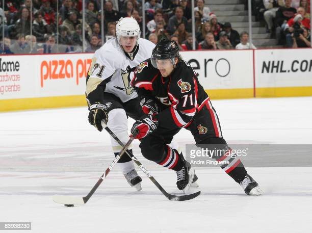 Nick Foligno of the Ottawa Senators stickhandles the puck past Evgeni Malkin of the Pittsburgh Penguins at Scotiabank Place on December 6, 2008 in...
