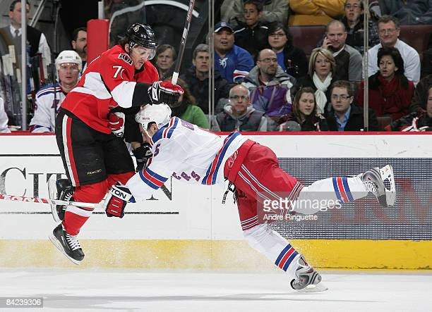 Nick Foligno of the Ottawa Senators tries to jump to avoid a check by Daniel Girardi of the New York Rangers at Scotiabank Place on January 10, 2009...