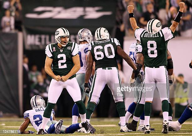 Nick Folk and Mark Brunell of the New York Jets celebrate after Folk kicked a successful 50yard gamewinning field goal against the Dallas Cowboys...