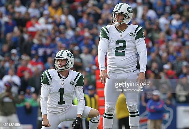 Nick Folk and Ryan Quigley of the New York Jets react to a missed field goal during NFL game action against the Buffalo Bills at Ralph Wilson Stadium...