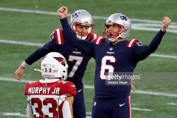 Nick Folk of the New England Patriots celebrates after kicking a 50 yard game winning field goal against the Arizona Cardinals during the fourth...