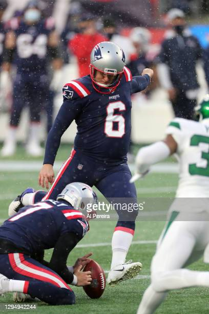 Nick Folk of the New England Patriots kicks a PAT in the snow against the New York Jets at Gillette Stadium on January 3, 2021 in Foxborough,...