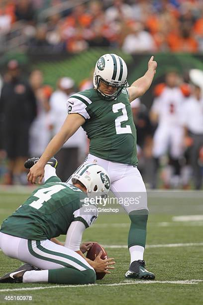 Nick Folk of the New York Jets connects for a field goal during the game against the Cincinnati Bengals at Paul Brown Stadium on August 16 2014 in...