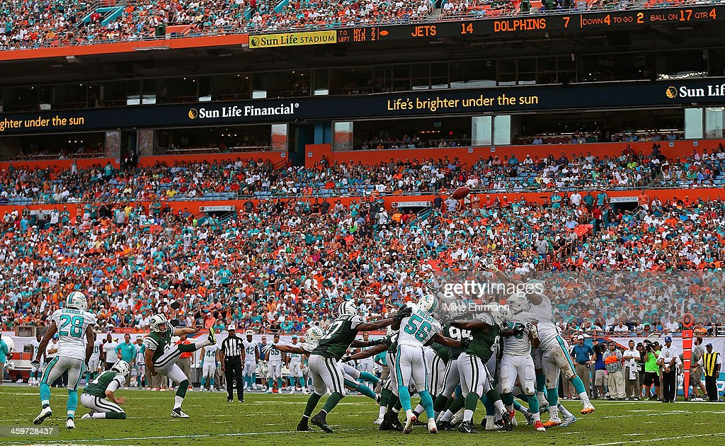 Nick Folk #2 of the New York Jets kicks a field goal during a game against the Miami Dolphins at Sun Life Stadium on December 29, 2013 in Miami Gardens, Florida.