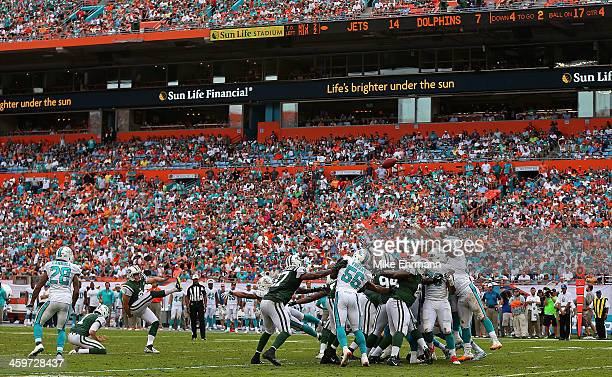Nick Folk of the New York Jets kicks a field goal during a game against the Miami Dolphins at Sun Life Stadium on December 29 2013 in Miami Gardens...