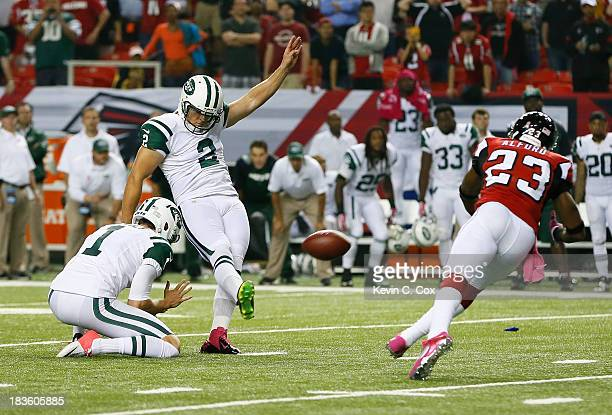 Nick Folk of the New York Jets kicks the gamewinning field goal as time expired against the Atlanta Falcons at Georgia Dome on October 7 2013 in...