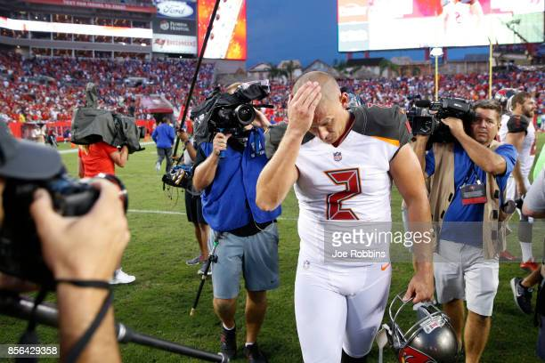 Nick Folk of the Tampa Bay Buccaneers reacts as he leaves the field after kicking the gamewinning 34yard field goal as time expired in a game against...