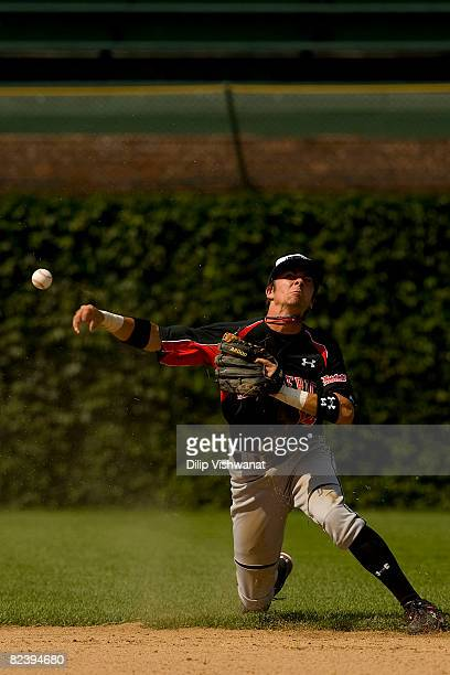 Nick Franklin of the Baseball Factory team throws to first base against Team One team at the Under Armour AllAmerica Baseball Game Wrigley Field...