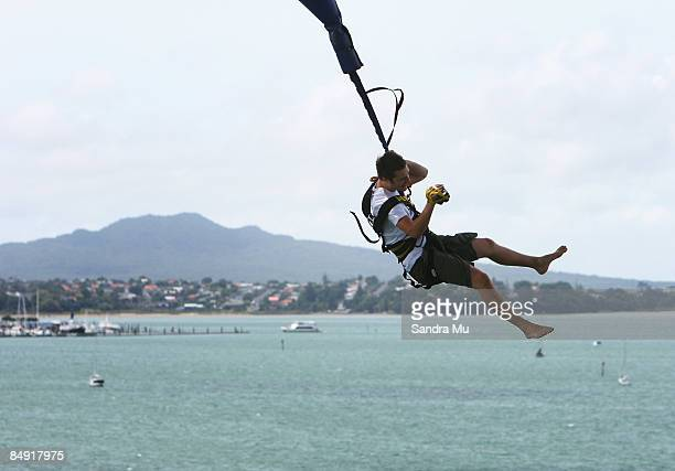 Nick Franklin uses a video camera to record his experience as the Crusty Demons bungee jump off Auckland Harbour Bridge February 19 2009 in Auckland...