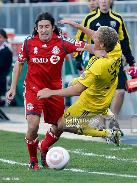 Nick Garcia of Toronto FC knocks over Steven Lenhart of Columbus Crew during a regular season MLS game at BMO Field October 16, 2010 in Toronto,...
