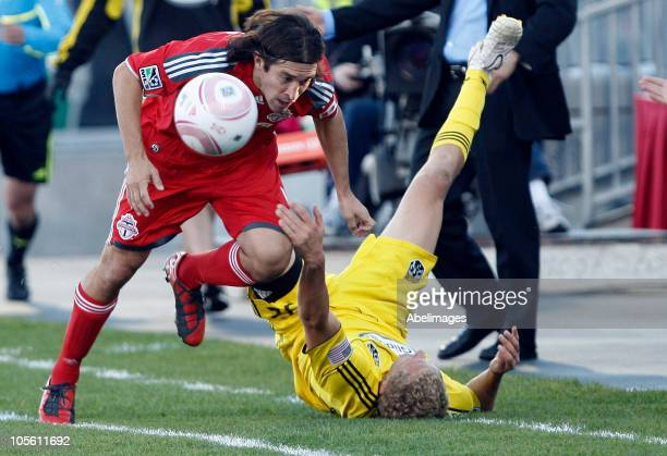 Nick Garcia of Toronto FC knocks over Steven Lenhart of Columbus Crew during a regular season MLS game at BMO Field October 16 2010 in Toronto...