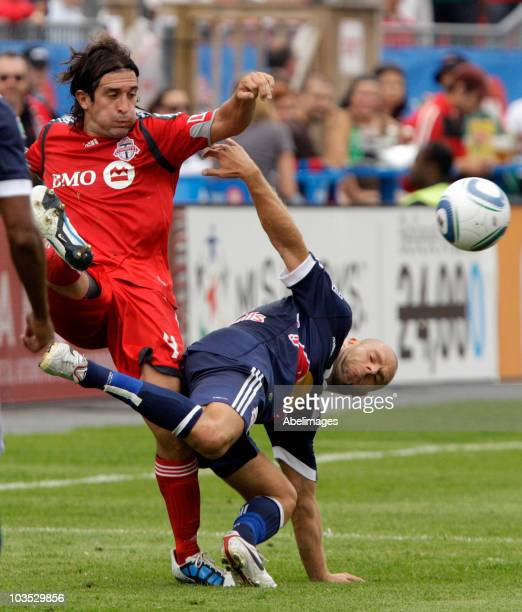 Nick Garcia of Toronto FC runs into Joel Lindpere of the New York Red Bulls during a MLS game at BMO Field August 21 2010 in Toronto Ontario Canada