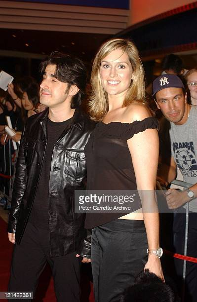 Nick Gianopolous and Kate Fischer arrive at the Australian premiere of the Mel Gibson film 'We Were Soldiers' at Hoyts Cinema George Street on April...
