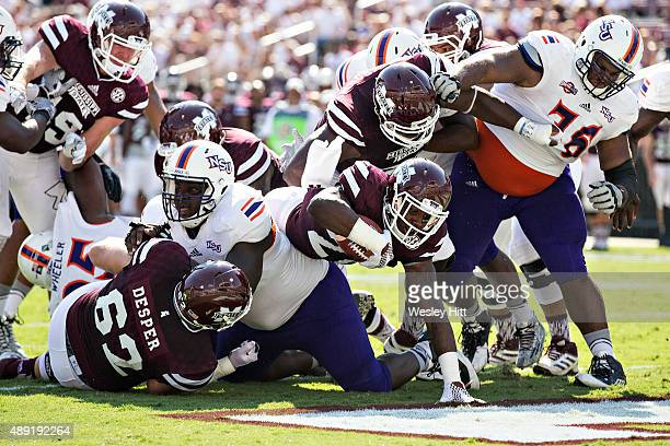 Nick Gibson of the Mississippi State Bulldogs rushes for a touchdown against the Northwestern State Demons at Davis Wade Stadium on September 19 2015...