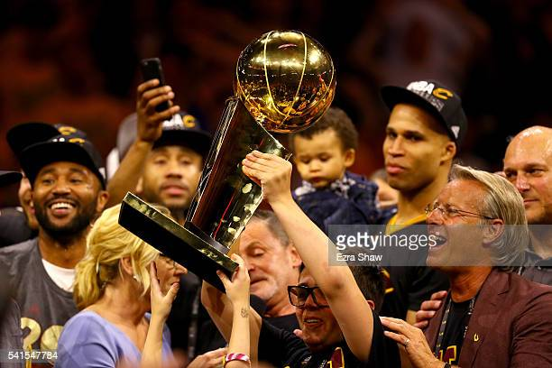 Nick Gilbert son of Cleveland Cavaliers owner Dan Gilbert holds the Larry O'Brien Championship Trophy after the Cavaliers defeated the Golden State...