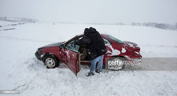 Nick Goetz leans against his car tired from pushing it out of the snow during a winter storm December 20 2012 in Baraboo Wisconsin The State Patrol...