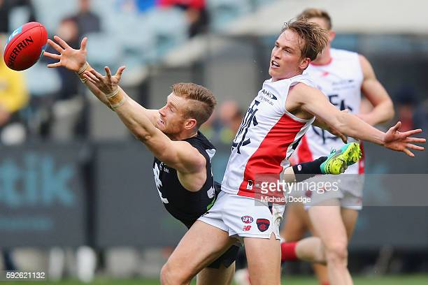 Nick Graham of the Blues and Bernie Vince of the Demons compete for the ball during the round 22 AFL match between the Carlton Blues and the...
