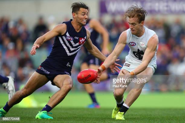 Nick Graham of the Blues gathers the ball against Lachie Weller of the Dockers during the round nine AFL match between the Fremantle Dockers and the...