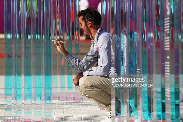 Nick Green, chef de mission of Australia gives an autograph during a ceremony at the Olympic Village ahead of the London 2012 Olympic Games at the...