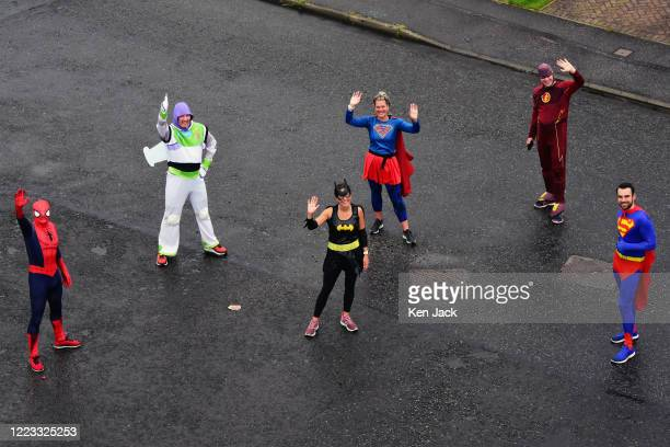 Nick Green from Dalgety Bay as Superman and fellow superheroes pause on a run through the streets to raise funds for Calaiswood School in Dunfermline...
