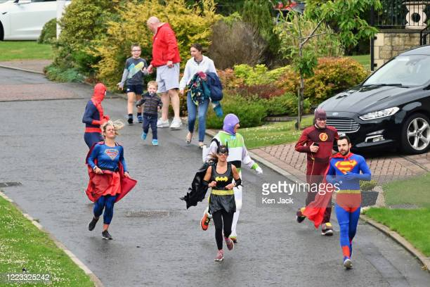 Nick Green from Dalgety Bay as Superman and fellow superheroes run through the streets to raise funds for Calaiswood School in Dunfermline which...