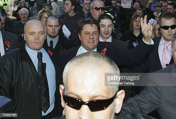 Nick Griffin , leader of the British National Party, gives a victory sign as he greets supporters outside Leeds Crown Court where he is facing a...