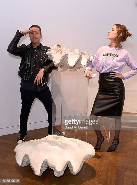 Nick Grimshaw and Alexa Chung attend the Shrimps SS17 Presentation dinner featuring Converse at Christie's on September 16 2016 in London England