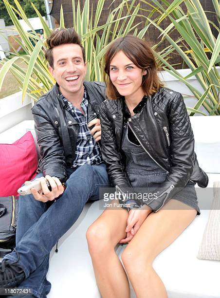 Nick Grimshaw and Alexa Chung posing at the Barclaycard Unwind VIP Pod during Wireless Festival 2011 at Hyde Park on July 3 2011 in London England