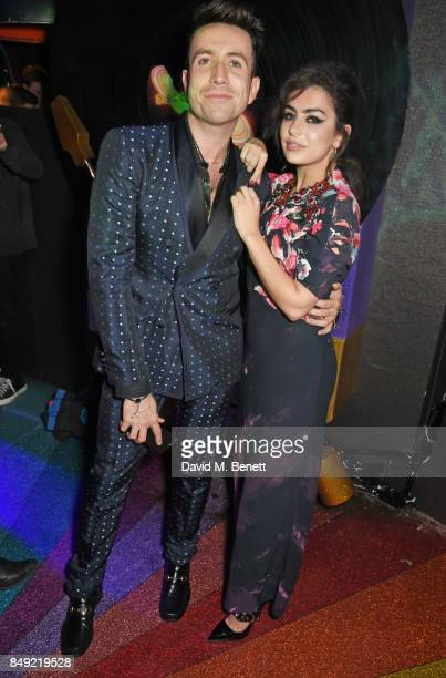 Nick Grimshaw and Charli XCX attend the LOVE magazine x Miu Miu party held during London Fashion Week at Loulou's on September 18 2017 in London...