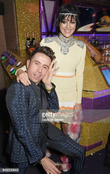 Nick Grimshaw and Eliza Cummings attend the LOVE magazine x Miu Miu party held during London Fashion Week in association with Absolut Elyx Perrier...