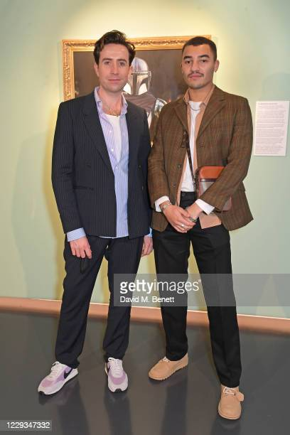 """Nick Grimshaw and Meshach Henry attend a private view of """"The Mandalorian And The Child"""", a special portrait being unveiled in collaboration with the..."""