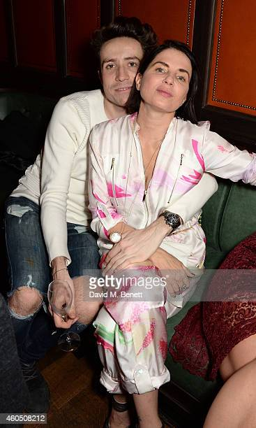 Nick Grimshaw and Sadie Frost attend the LOVE x Balmain Xmas Party at The Ivy Market Grill on December 15 2014 in London England